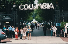 "baloons spelling the word ""columbia"" hang on the Columbia University gates"